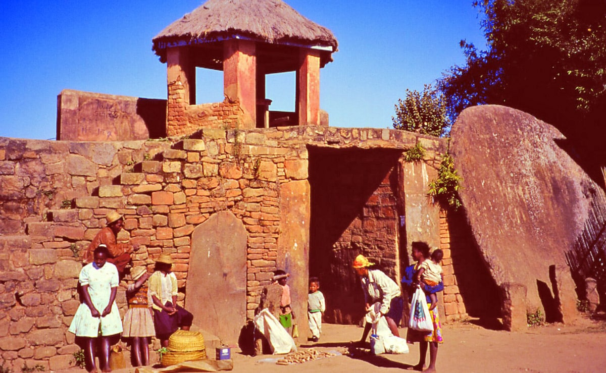 Gate of Ambohimanga in Madagascar. The megalithic stone disc - door is visible
