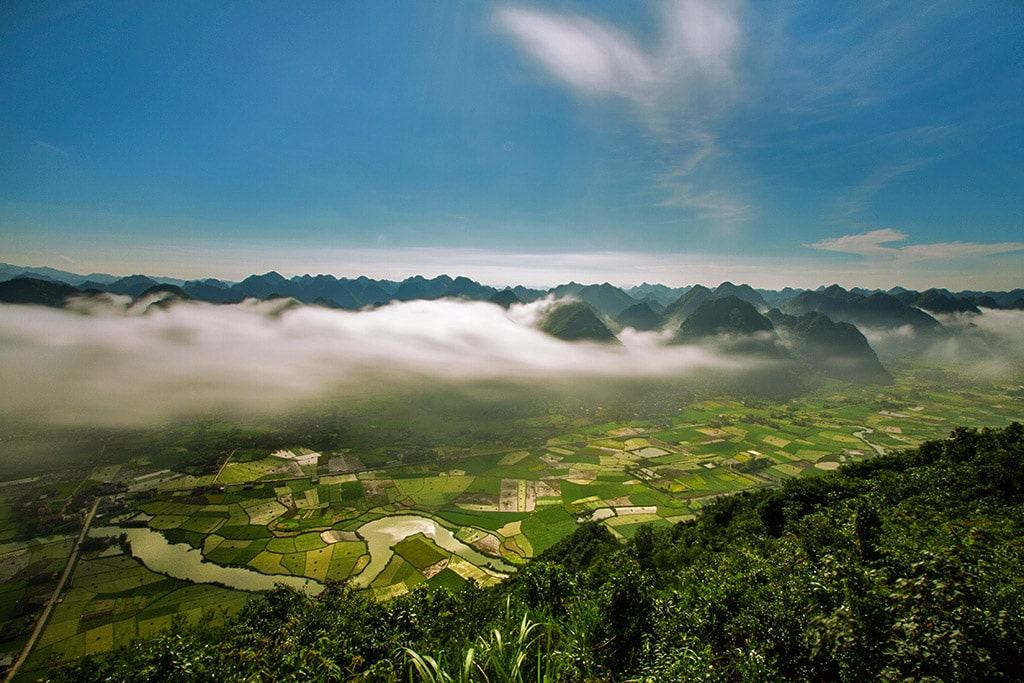 Early morning and fog over a valley in Bắc Son, Vietnam