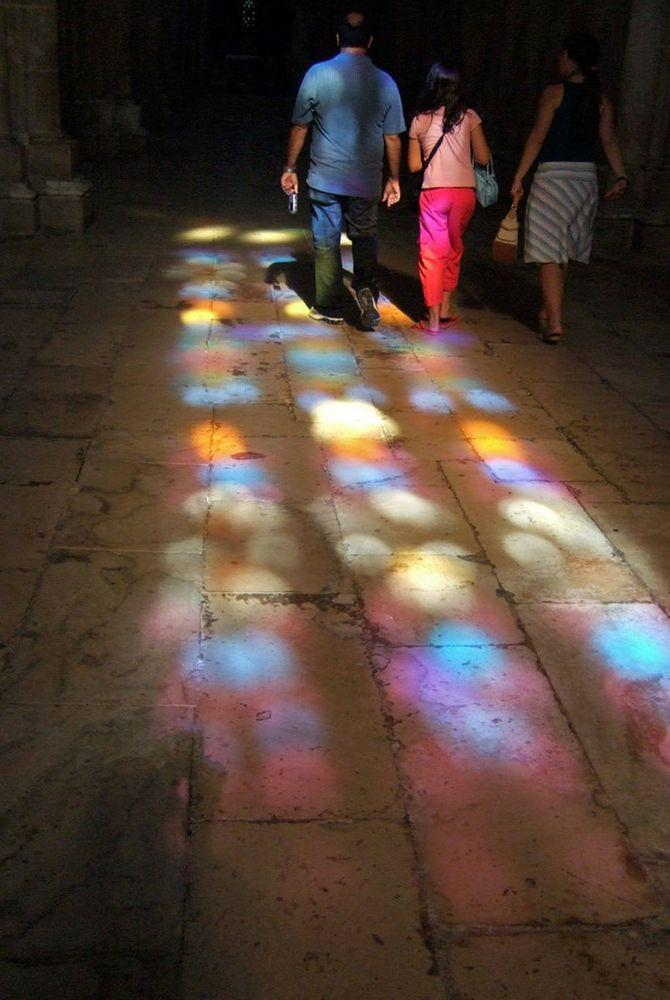 Lights from the stained glass in the church of Batalha Monastery, Portugal