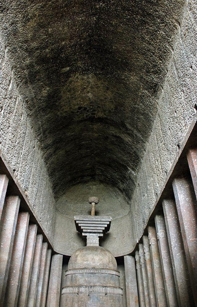 Ceiling in Bedse Caves is bare, without adornment. Five columns with ornaments are visible
