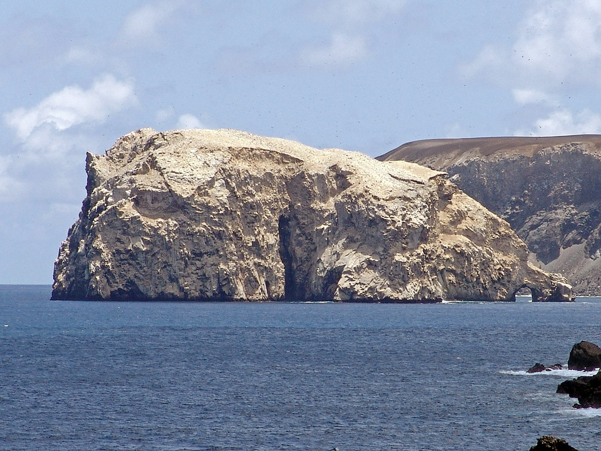 Boatswain Bird Island with natural arch, Ascension Island