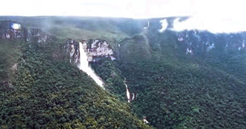 Desabamento Falls after heavy rains. Some 200 m tall Surpresa Falls seen in the far background