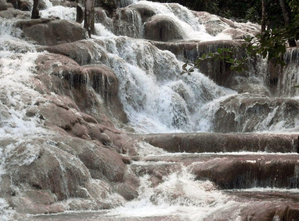 Water falls over the precipitated tufa, Dunns Falls in Jamaica