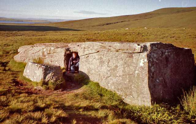 Dwarfie Stane, with a man in entrance, Orkney Islands