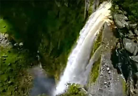 Eldorado Falls from above. Group of tourists in the forefront