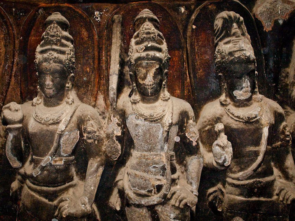 Ghostly statues in Ellora Caves, India