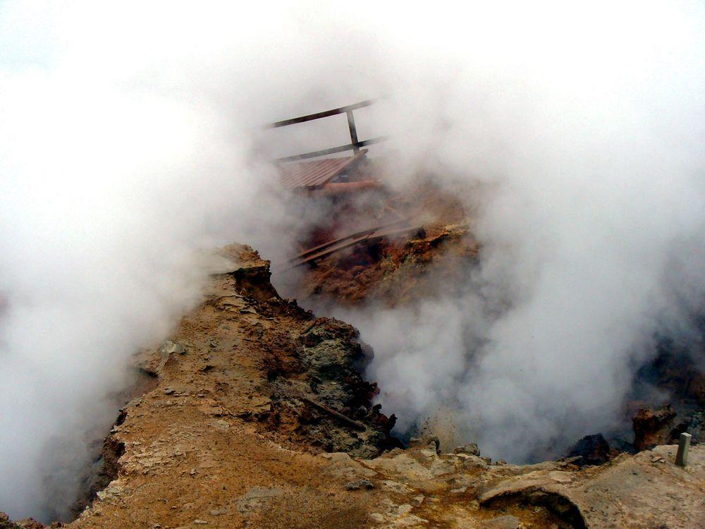 Gunnuhver geothermal area, collapsed visitors platform seen through the fume of fumarole