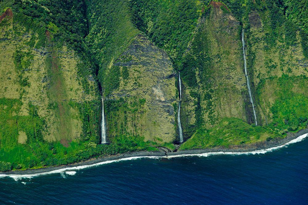 Group of tall waterfalls, northern coast of Hawaii. Nakooko Falls in the centre, Ohiahuea Falls - in the right side and Wai'apuka Falls in the left.