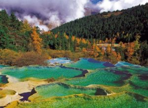 Travertine pools in Huanglong Valley, China