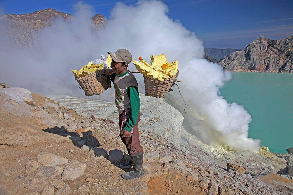 Sulphur miner in Ijen Crater, Indonesia