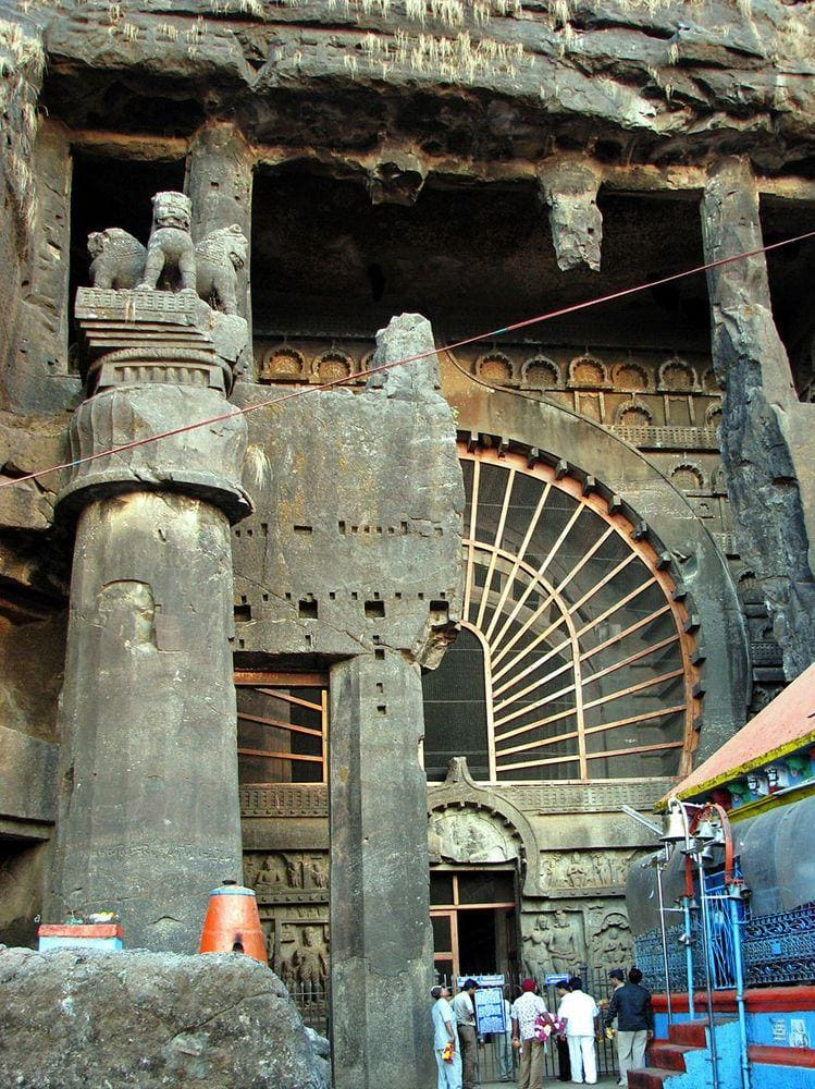Karla Caves - entrance, partly obtruded by contemporary Hindu temple