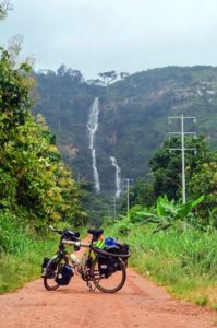 Kpalimé Falls with the bike of globetrotter Jean-Baptiste Dodane in the front, Togo