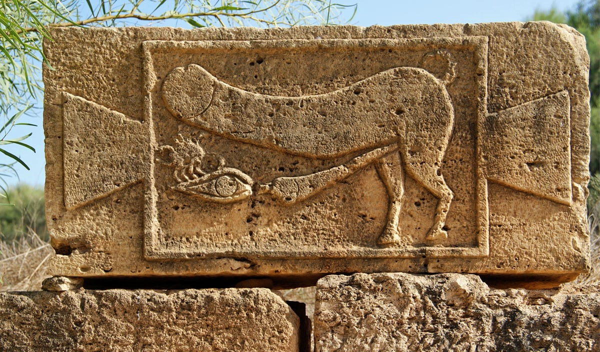 This phallic image is not a sign of red light district - it wards off the evil eye. Similar reliefs often were placed over the lintels of entrance doors in Leptis Magna, Libya
