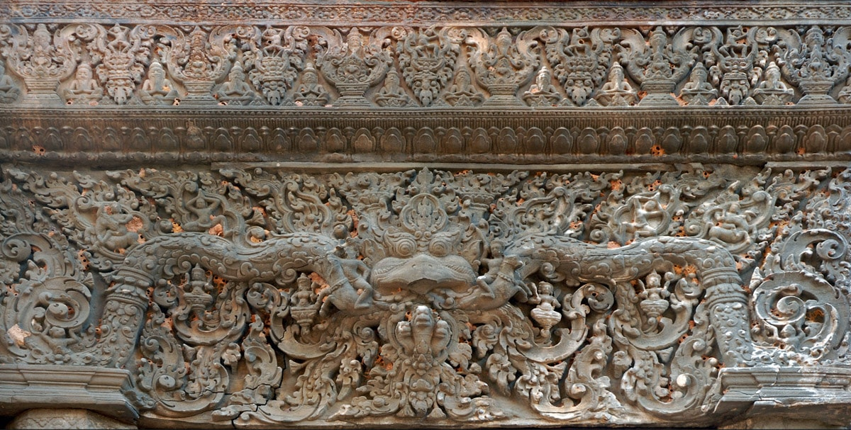 Intricate stone carving in Lolei temple in Cambodia, the late 9th century