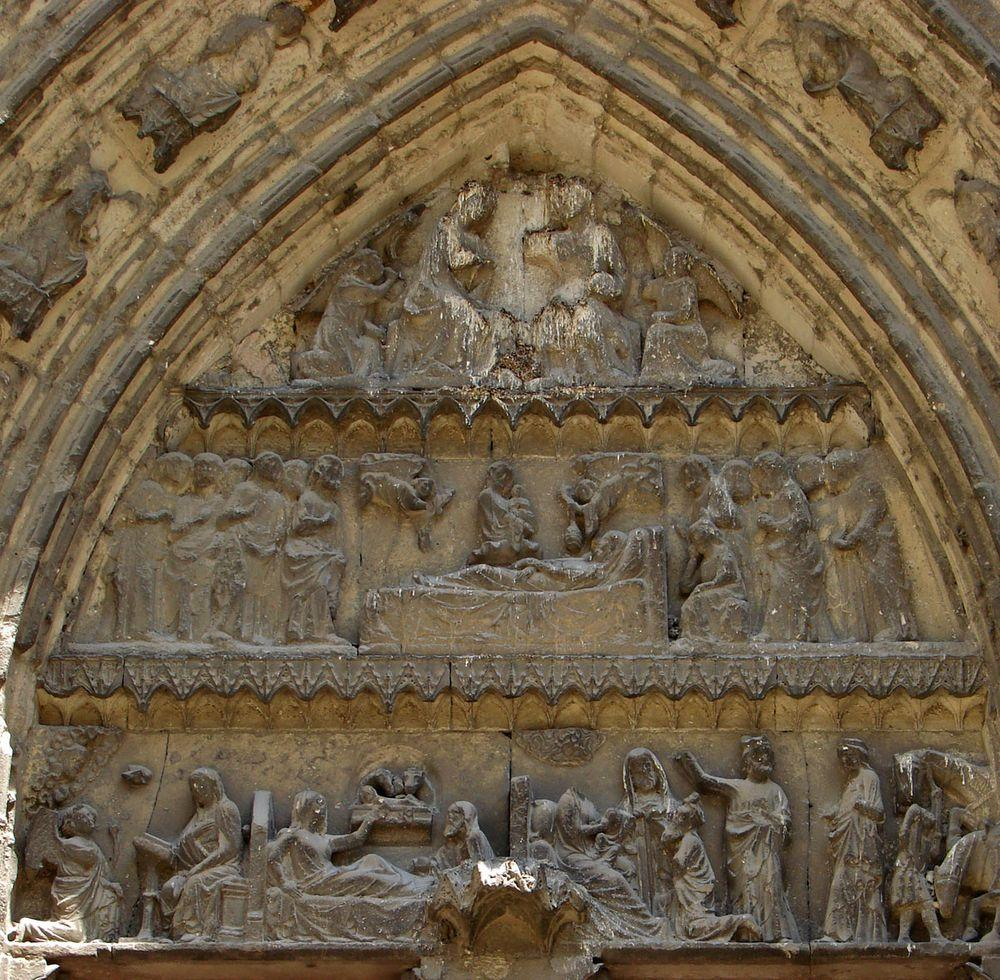 Western facade of Meaux Cathedral. Sculptural groups show Annunciation, Nativity, Dormition of Virgin and Coronation of Virgin