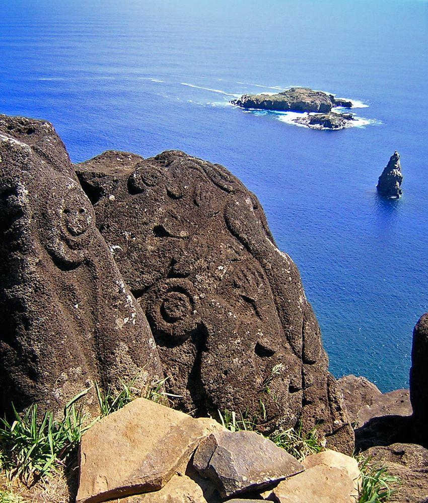 Orongo petroglyphs with Motu Nui islands in the background, Rapa Nui