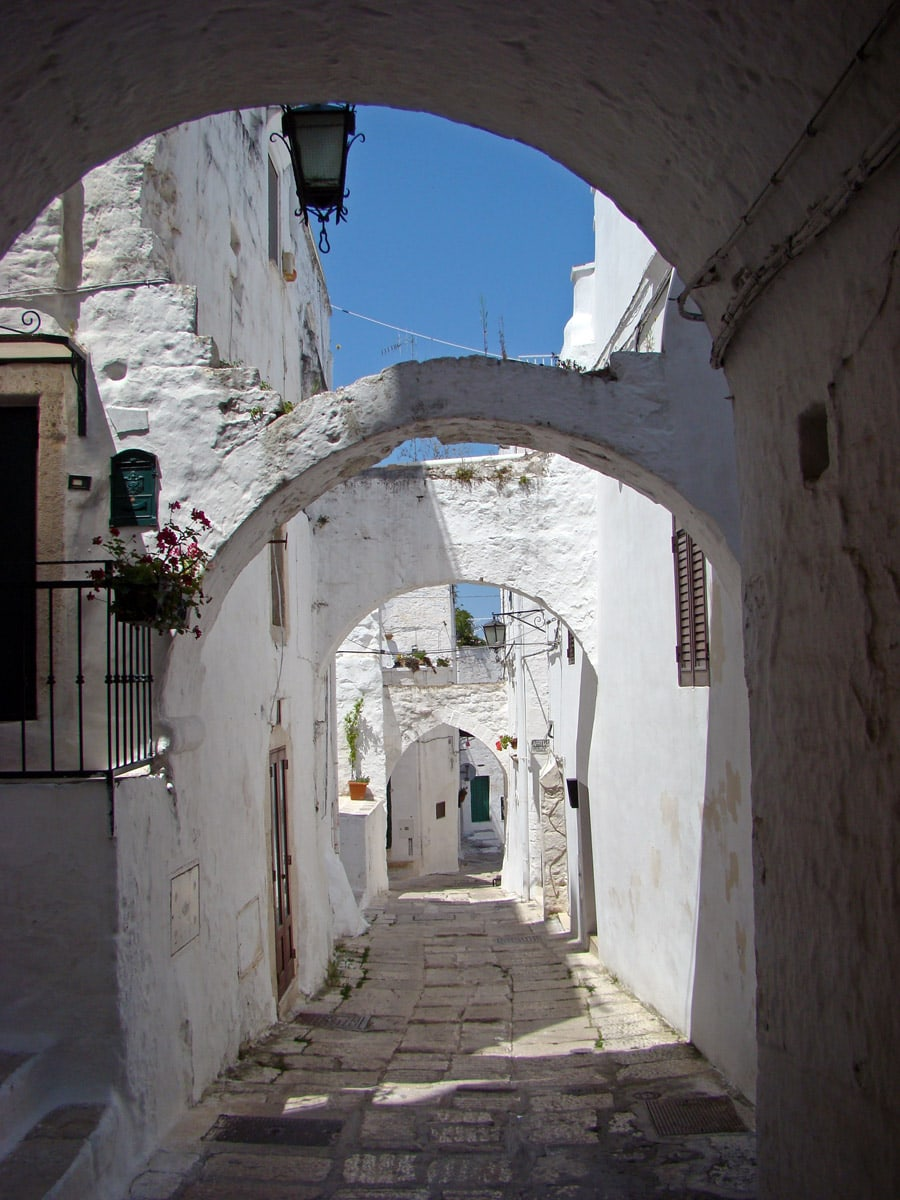 Street with arches in Ostuni, Italy