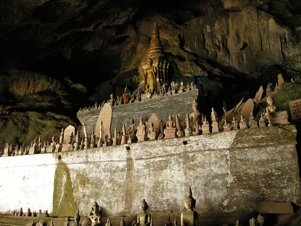 One of Pak Ou caves with statues of Buddhas, Laos