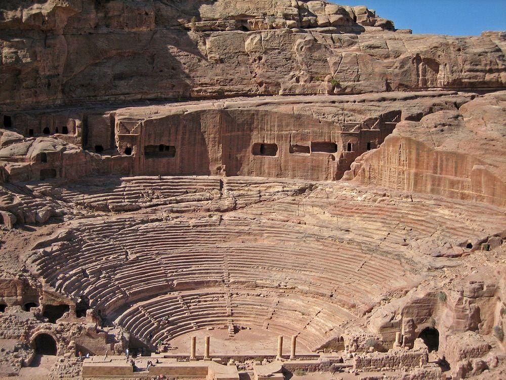 Roman theater with remnants of ancient tombs seen in the background, Petra in Jordan