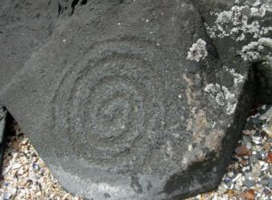 Petroglyph Beach in Alaska, stone with a carving of spiral