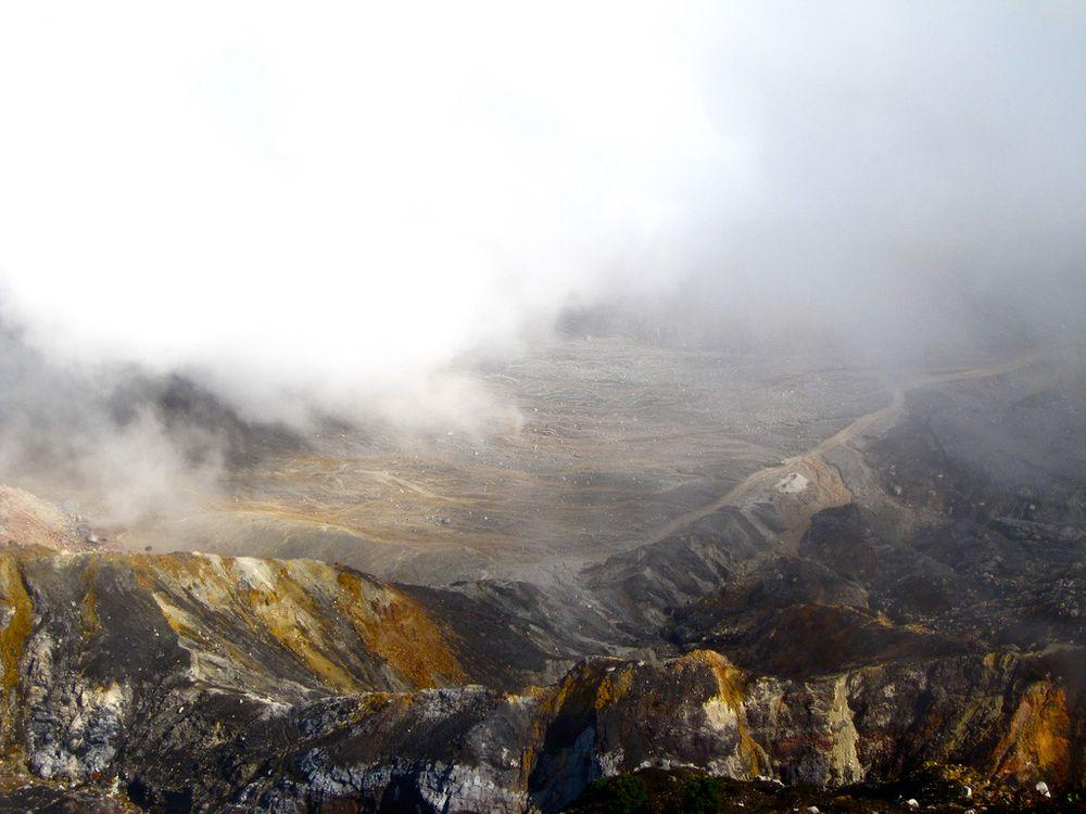 Acid fog and lifeless plain around Poas volcano