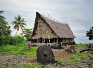 Rai of Yap in the front of meeting house