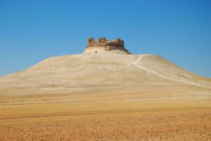 Shmemis Castle ruins on the top of extinct volcano, Syria