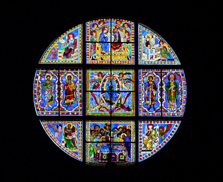 Stained glass window, made by Ducio di Buoninsegna in 1287 - 1288. Siena Cathedral in Italy