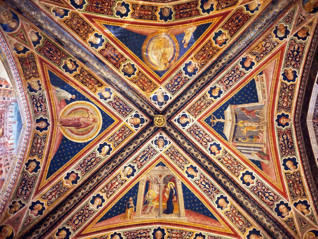 Frescoes on the ceiling of baptistry of San Giovanni, Siena Cathedral in Italy