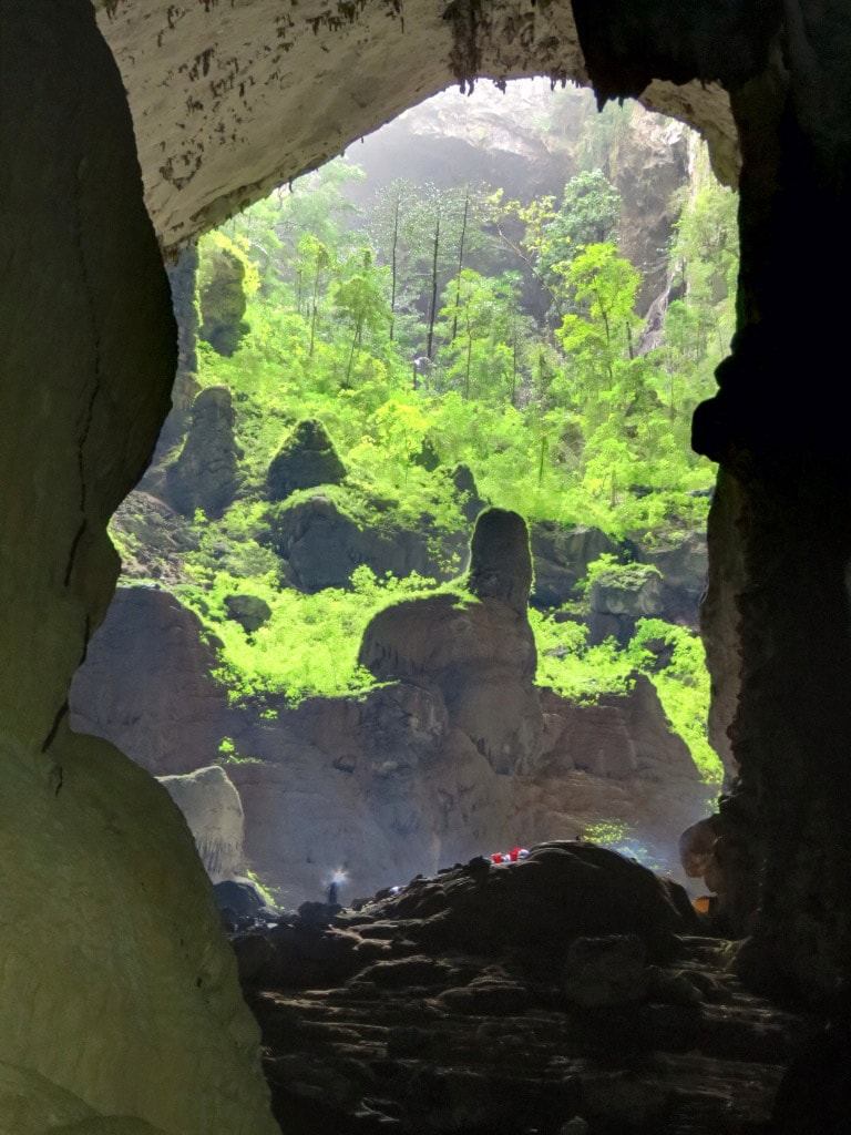 Son Doong cave at one of sinkholes. Note the camp and people