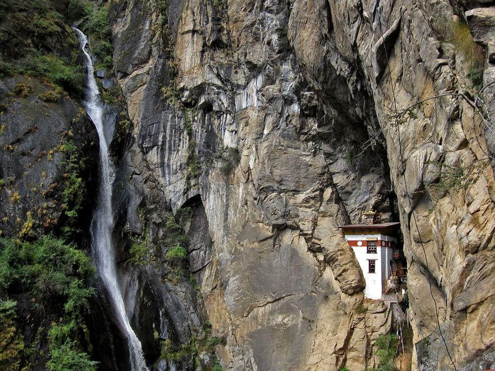 Waterfall near Paro Taktsang and guardhouse, Bhutan