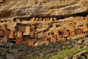 Teli village in Mali - Dogon houses in the forefront, Tellem houses - in the cliff