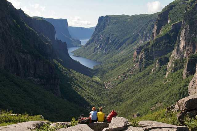 Western Brook Pond. Pissing Mare Fall are seen as a thin white line over the cliffs in the left side of image