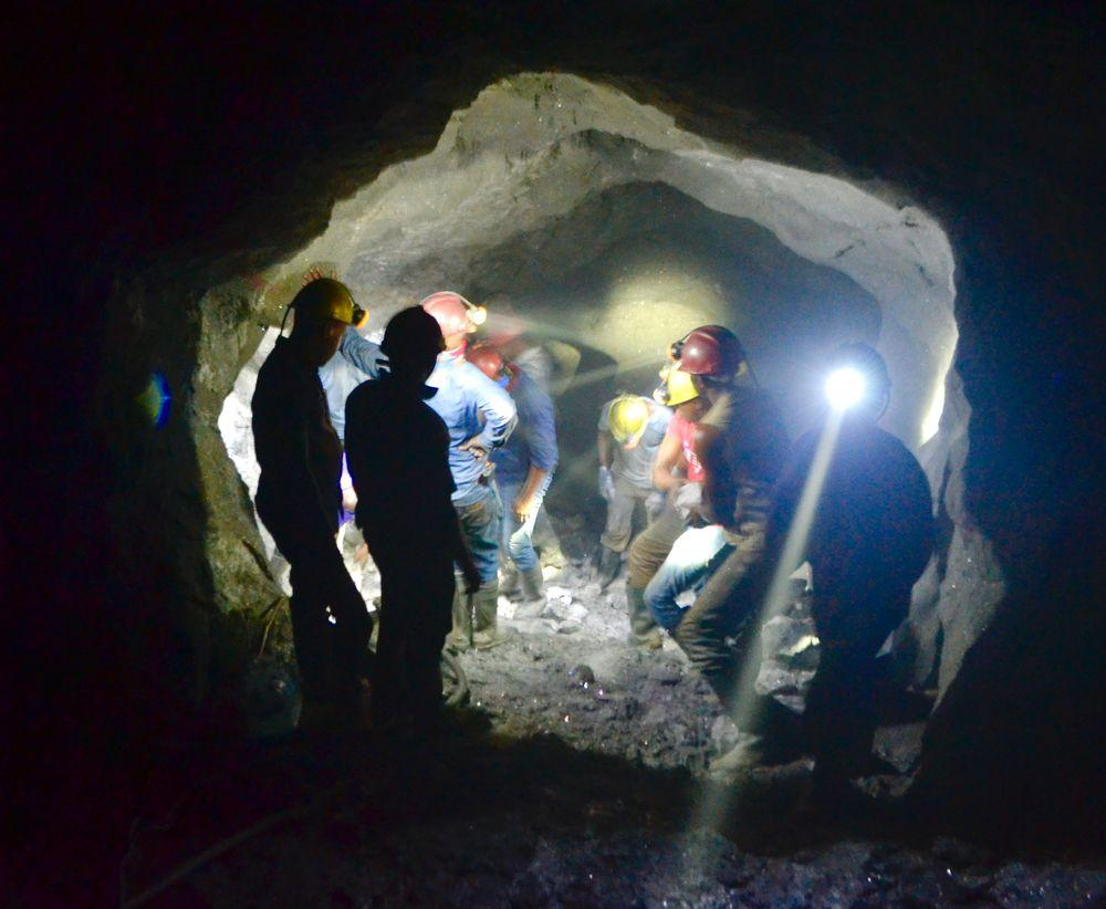 Workers in tanzanite mine