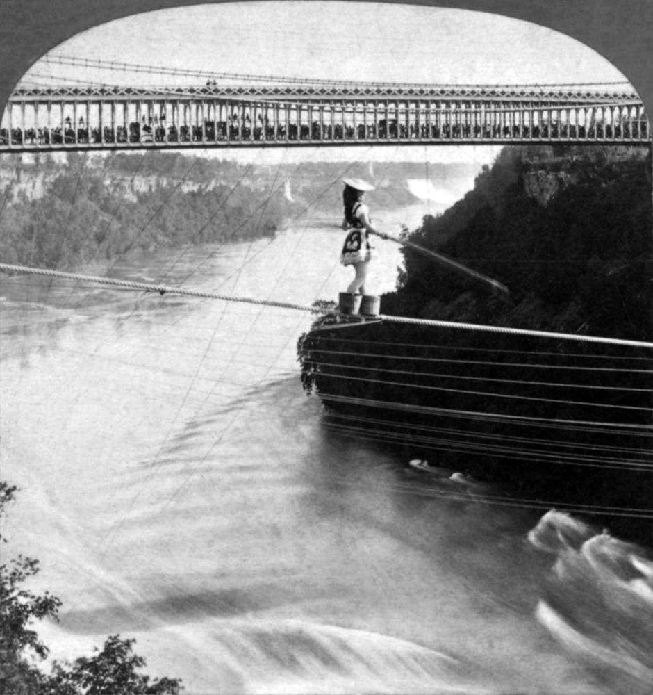 Maria Spelterini in peach baskets crosses Niagara Gorge, 1876