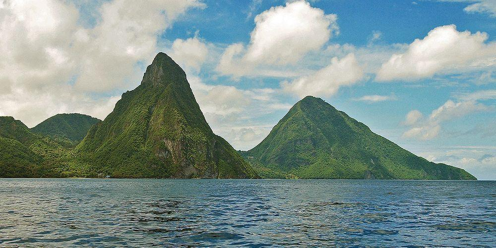 Pitons - main landmark of Saint Lucia. Petit Piton is the steepest mountain